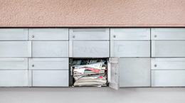 A mailbox stuffed with envelopes and mail