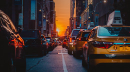traffic in a city, sunset