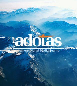 Adotas logo overtop a blue mountain range