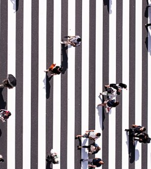 people crossing crosswalk