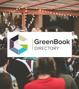 group of people outside with greenbook logo