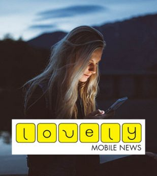 Girl looking at phone in dark with lovely mobile logo
