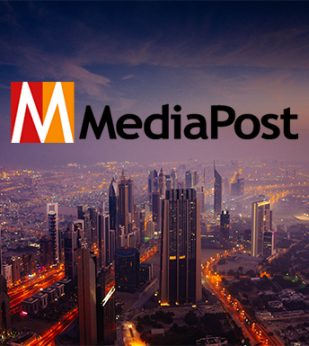 Media Post logo overlayed on a city at dusk