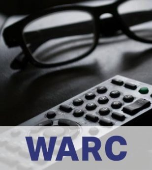A television remote and a pair of glasses sit on a couch cushion, in black and white.. The WARC logo is below in a white band.