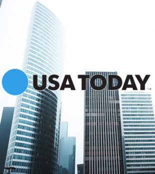 glass buildings with USA Today logo overlayed