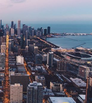 An aerial view of Chicago looking out over Lake Michigan.