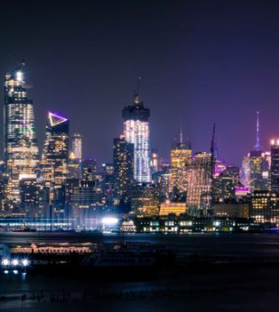 NYC skyline lit up at night