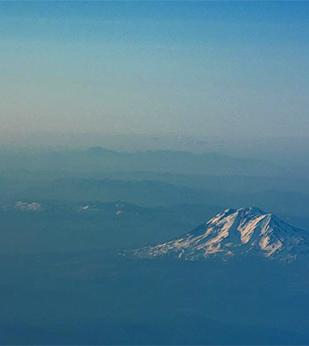 mountains in cloudy haze