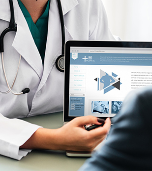 doctor pointing to screen while talking with patient