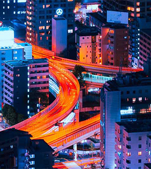 city streets lit by cars passing