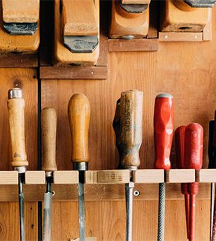 wood working tools hung on wall