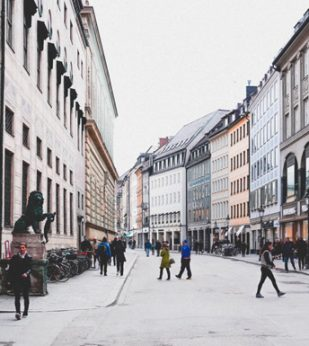 People walking along the street in Munich, Germany.