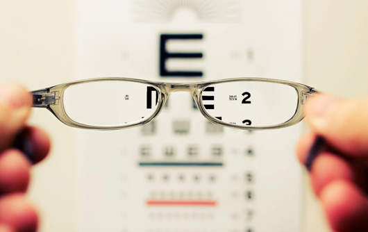 View of an eye exam through a pair of glasses