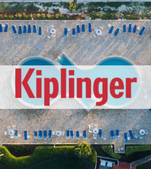 Aerial view of a swimming pool and pool chairs. Kiplinger logo is across the middle.