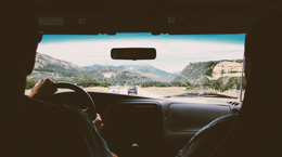 View of a road trip from inside the car.