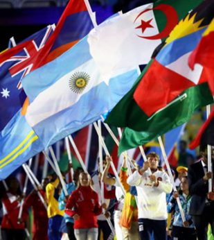 Athletes walk with their country flags at Olympic Games.