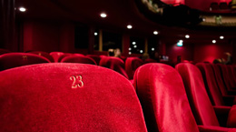 A view of empty red theater seats