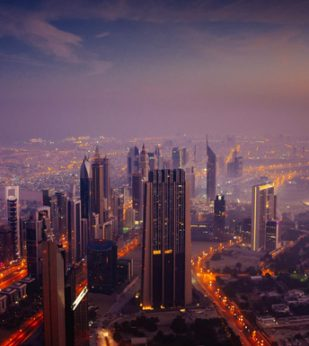 A view of the city of Dubai at sunrise
