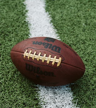 A football sits on a field