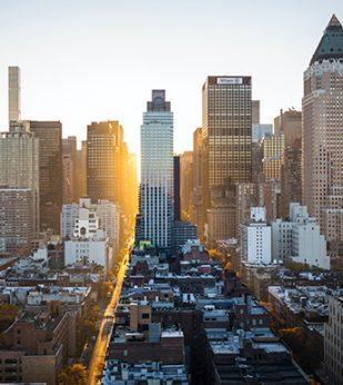 Sun rises over a city skyline