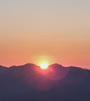 Sun rises over the mountains