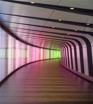 A windy hallway with colored lights