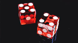 A pair of red dice on a black background