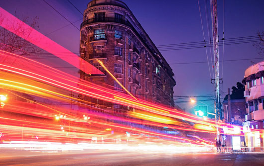 Light trails on vehicles in the city
