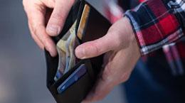 A man holds open a wallet
