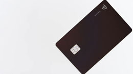 A black credit card against a white backdrop