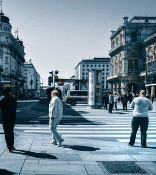 People walk around a city