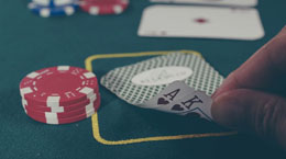 Someone shows two cards in a casino card game